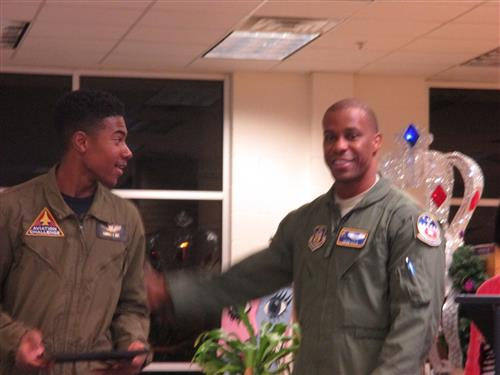 Major Adam Cole with our STEAM Club Vice President, Channing Gray, a certified pilot