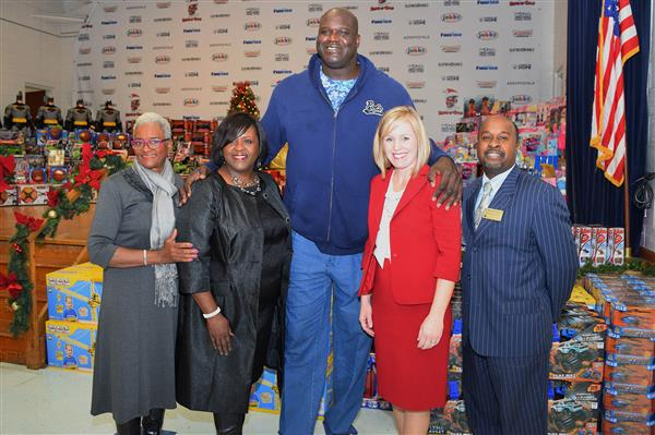 Working with Fairview Elementary in surprising all student with a Christmas from Shaq